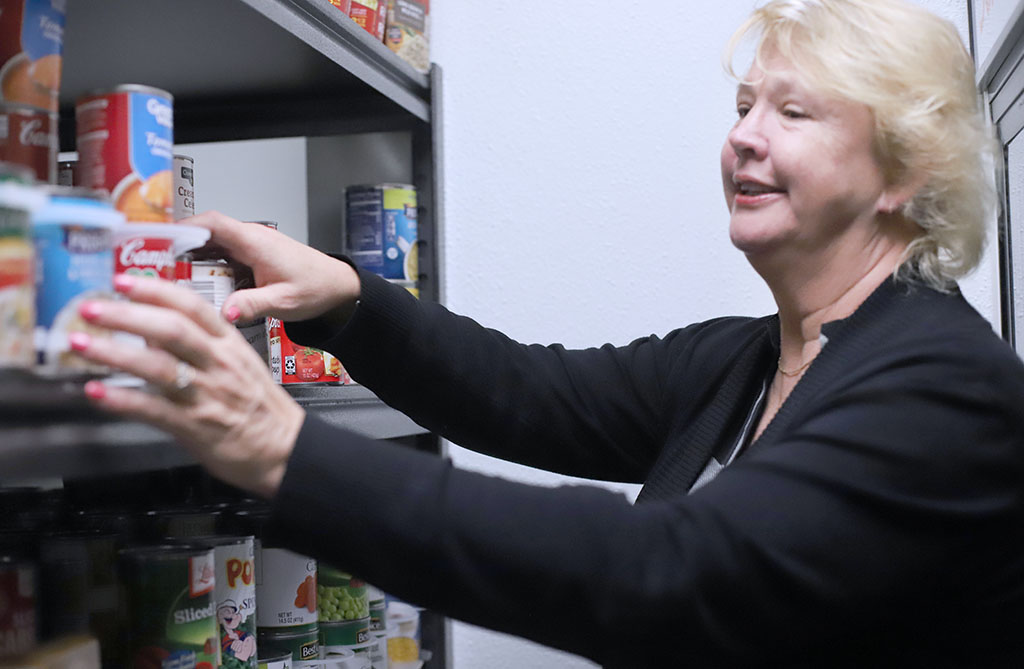 Special events coordinator, Cynthia Cummings checks inventory at the Mustangs Food Pantry. Jan. 29. Photo by Bridget Reilly