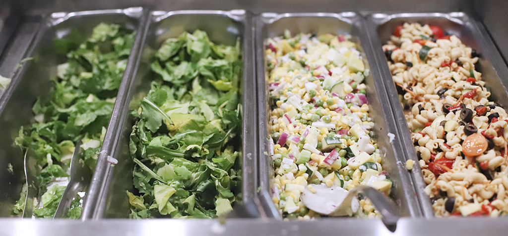 Salad bar options in Mesquite Dining Hall include a colorful pasta salad and corn dish. Jan 22. Photo by Bridget Reilly