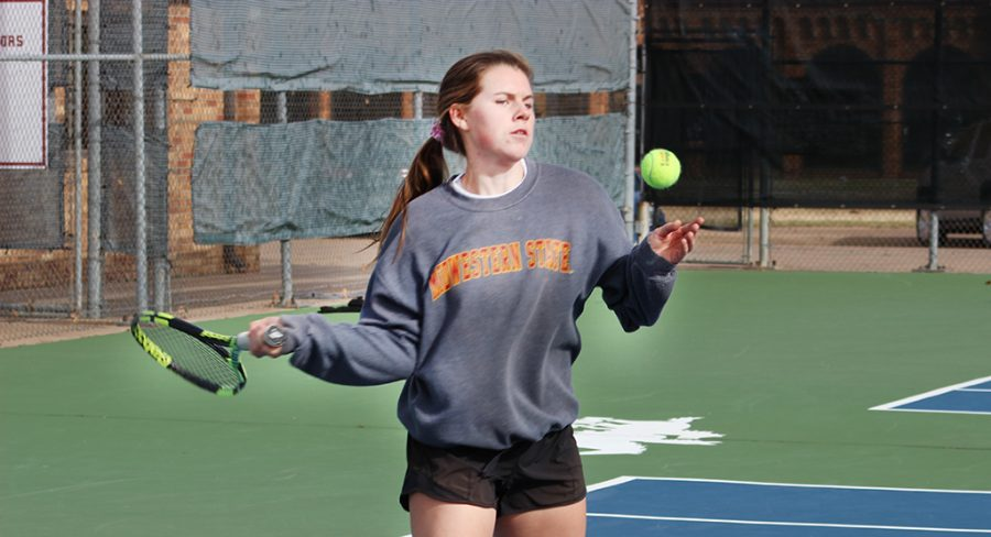 Biology+Senior+Maddy+Coffman+prepares+to+strike+forehand.+Jan+21.+Photo+by+Sharome+Burton.