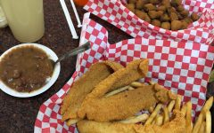 fried catfish, red beans and rice, fries, and fried okra with drinks on the side