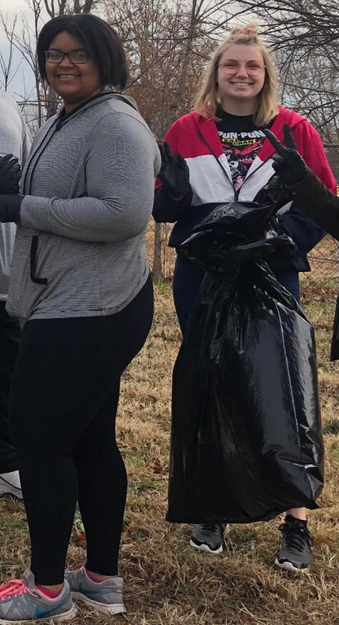 Anissa Williams, art sophomore, and Kristen Longo, art freshman, pick up trash at Adopt-A-Trail.