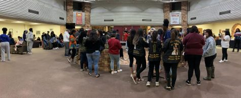 Students gathering in the Clark Student Center in preparation for the Greek life stroll