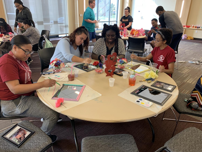 Jaye Surles, Dallas Wabbington, Desireè Harris and Alexis Osborne crafting at SAD event in Legacy Multipurpose Room.