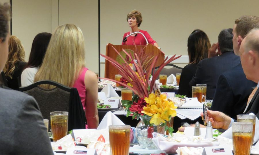 Janice Buss, presenting at the Business Etiquette Dinner in 2018 in the Clark Student Center.