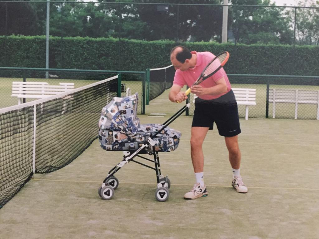 Baby+management+senior+Greta+Lazzarotto+getting+taught+her+first+tennis+lesson+by+her+father.+May%2C+1996
