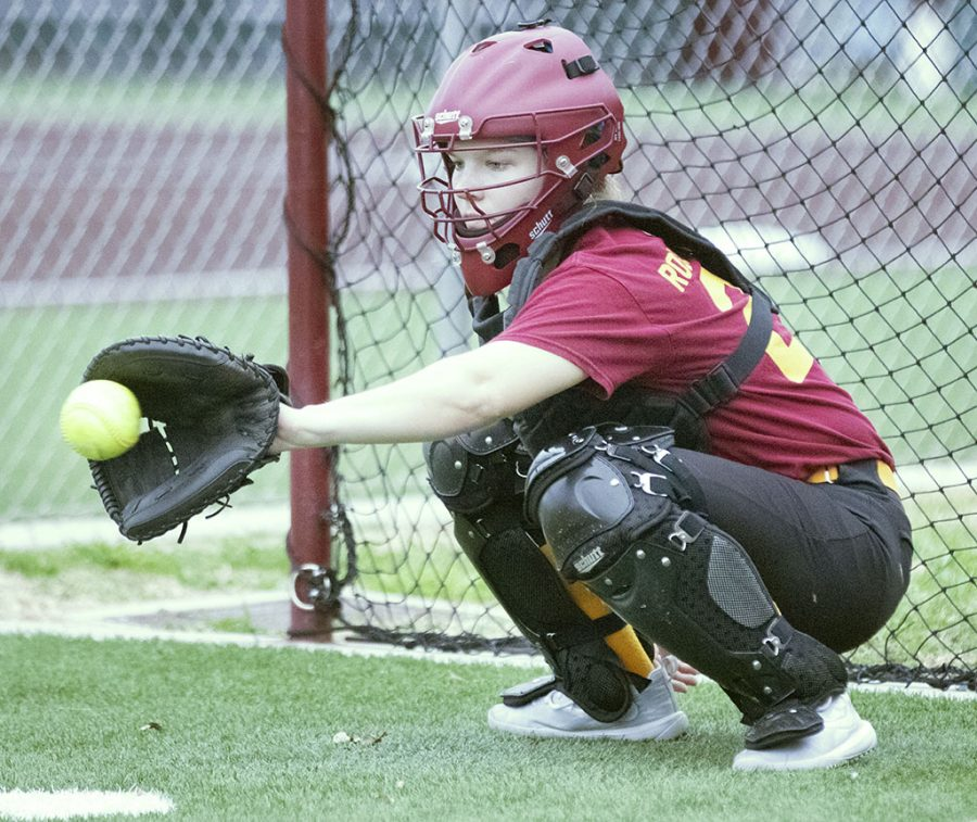 Athletic+training+senior+and+catcher+Jenna+Hering+practices+catching+with+nursing+senior+and+utility+player+Tucker+Caraway.+Hering+has+chosen+to+complete+her+senior+year+as+a+student-athlete+in+softball%2C+playing+as+catcher+for+the+Mustangs%2C+Feb.+5.+Photo+by+Bridget+Reilly