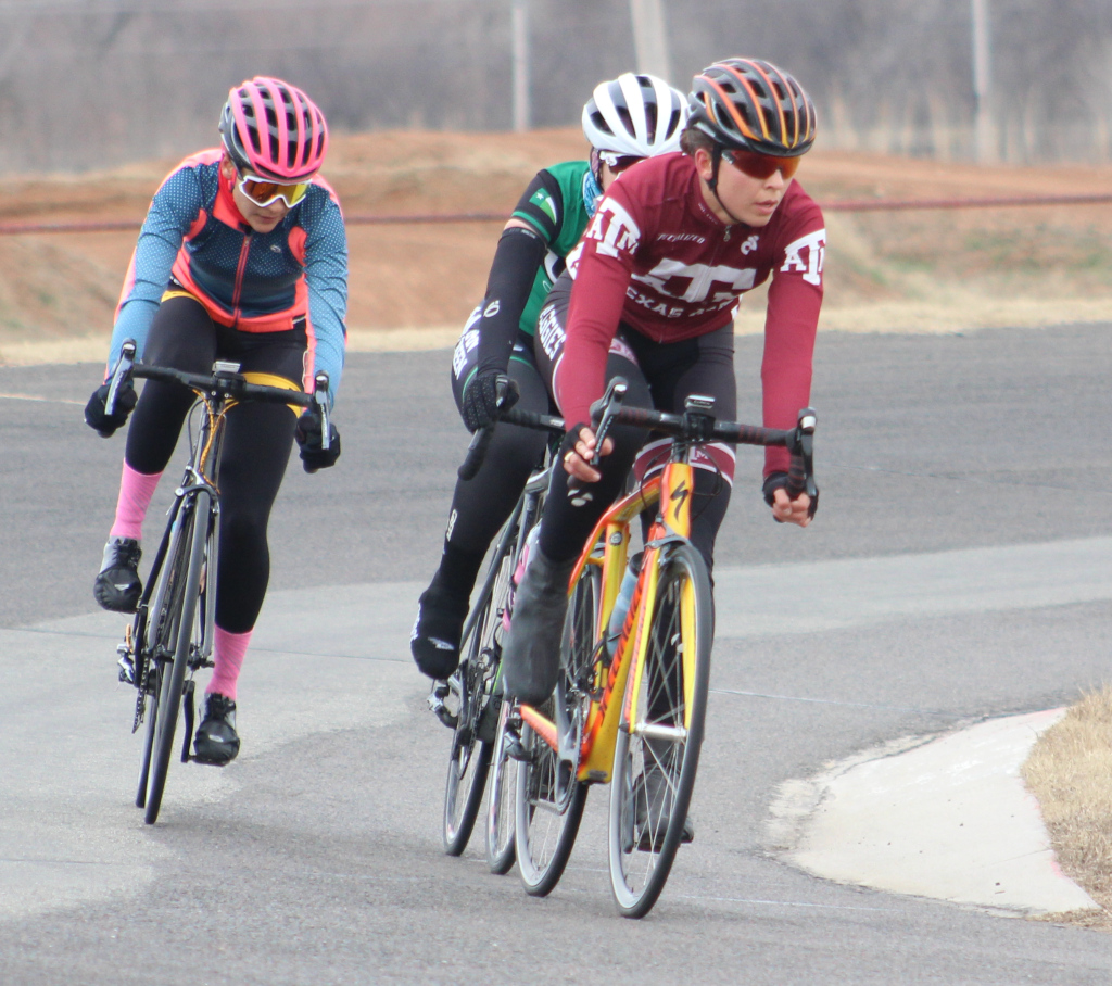 Brissia+Montalvo+%28+left%29%2C+exercise+physiology+graduate+takes+corner+during+women%27s+%27A%27+criterium.+Photo+by+Sharome+Burton.+March+10.