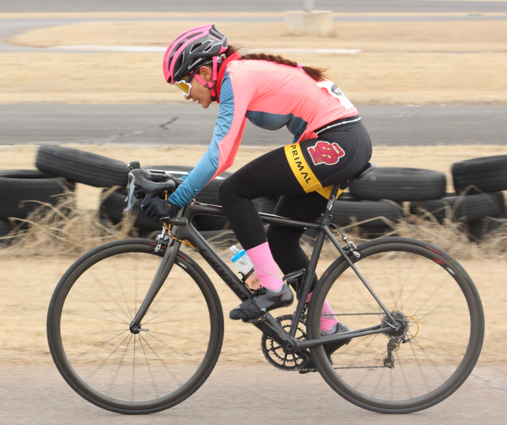 Brissia+Montalvo%2C+exercise+physiology+graduate+holds+drops+while+accelerating+during+women%27s+%27A%27+criterium.+Photo+by+Sharome+Burton.+March+10.