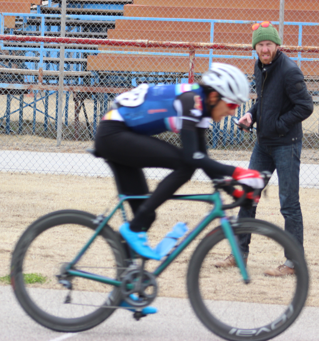 Cycling+director+Charlie+Zamastil+looks+on+as+Pablo+Cruz+builds+on+20-second+lead+in+men%27s+%27A%27+criterium+race.+Photo+by+Sharome+Burton.+March+10.