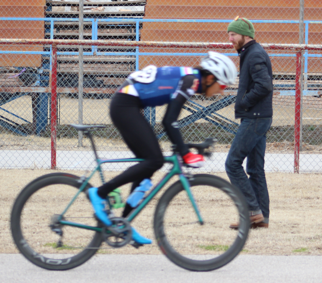 Cycling+director+Charlie+Zamastil+looks+on+as+Pablo+Cruz+maintains+lead++with+three+laps+remaining+in+men%27s+%27A%27+criterium+race.+Photo+by+Sharome+Burton.+March+10.