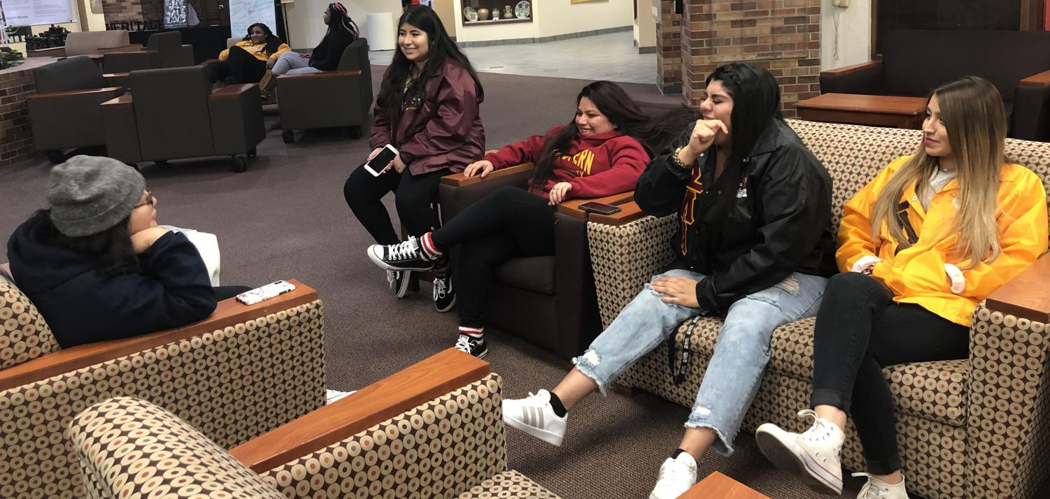 Social work junior Zelma Delgado, radiology sophomore Ashley Gonzales, nursing sophomore Luz Garcia, radiology freshman Vanessa Quinones, and nursing freshman Carolina Beltran chatting in the atrium before CGC Wave check on Feb. 28.