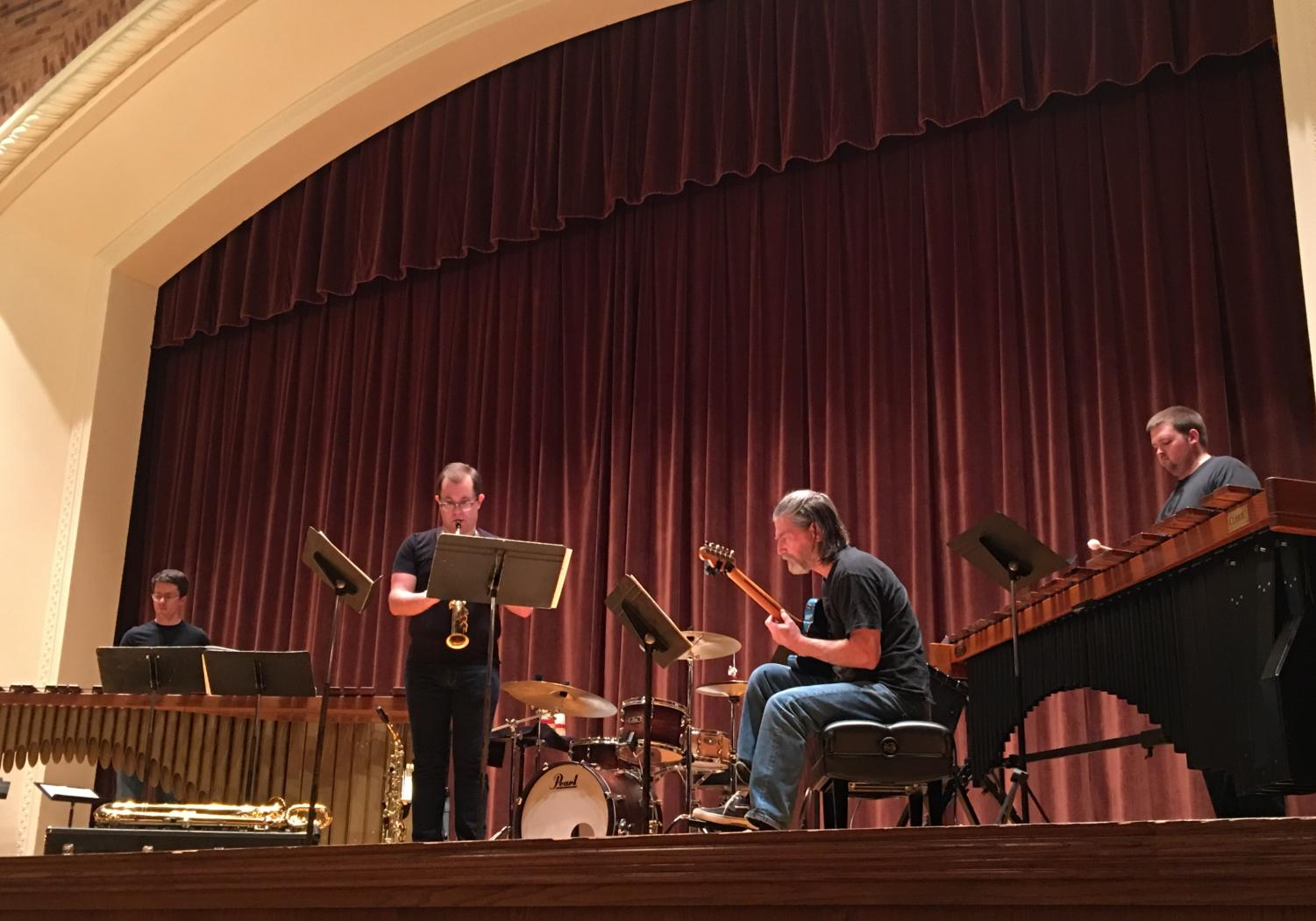Faculty members Andrew J. Allen, saxophone and Gordon Hicken, marimba with Geoff Martin, marimba and Bruce Canifax, guitar playing Smoke by Marc Mellits. Photo by Peyton Alonzo.