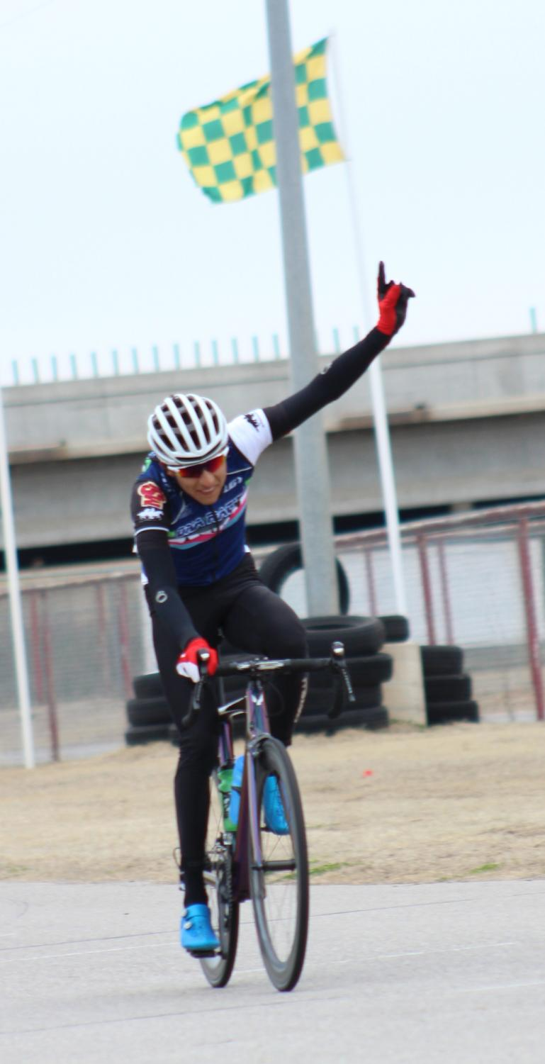 Pablo+Cruz%2C+exercise+physiology+senior+celebrates+solo+win+in+men%27s+%27A%27+criterium.+Photo+by+Sharome+Burton.+March+10.