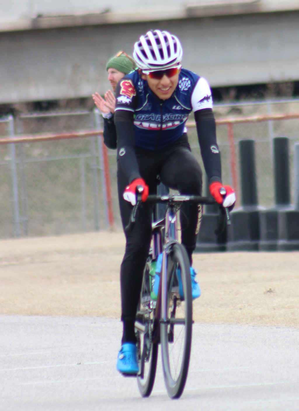 Pablo+Cruz+%28right%29+relaxes+after+winning+men%27s+%27A%27+criterium+while+cycling+director+Charlie+Zamastil+commends+team.+Photo+by+Sharome+Burton.+March+10.