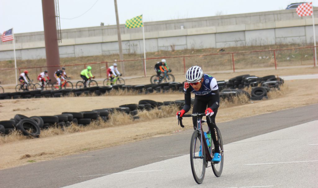 Pablo+Cruz%2C+exercise+physiology+senior+holds+onto+10-second+lead+against+chasing+group+in+men%27s+%27A%27+criterium.+Photo+by+Sharome+Burton.+March+10.