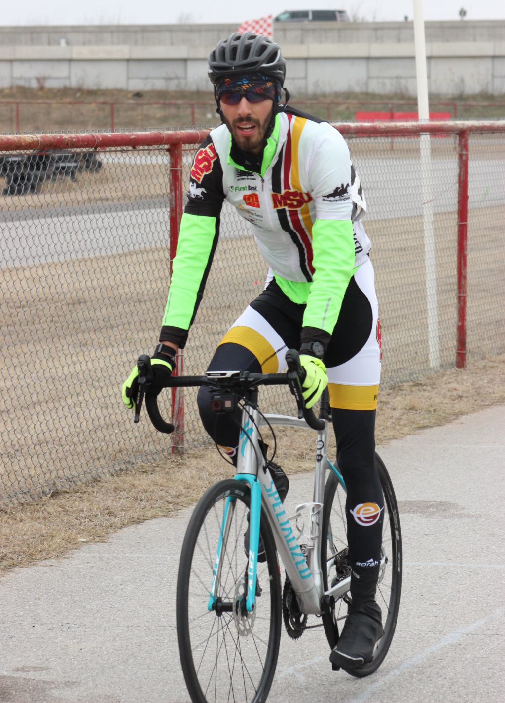 Ramon+Rueda%2C+exercise+physiology+graduate+warms+down+after+finishing+4th+in+men%27s+%27C%27+criterium+race+in+Norman%2C+Oklahoma.+Photo+by+Sharome+Burton.+March+10.