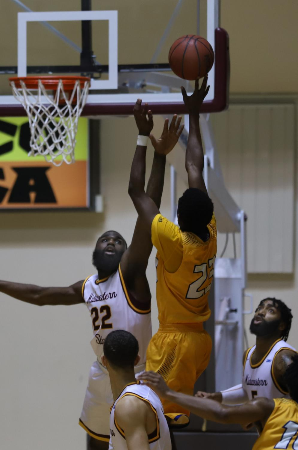 Gilbert+Thomas%2C+general+studies+junior+contests+last-second+shot+from+Texas+A%26M+Kingsville+player.+Photo+by+Sharome+Burton.+March+2.