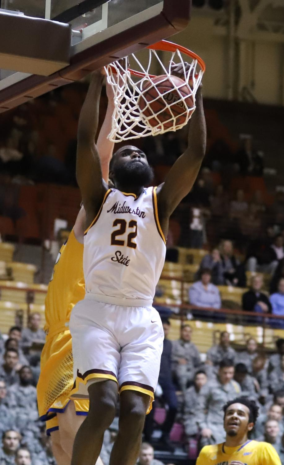 Gilbert+Thomas%2C+general+studies+junior+completes+his+second+dunk+against+Texas+A%26M+Kingsville.+Photo+by+Sharome+Burton.+March+2.