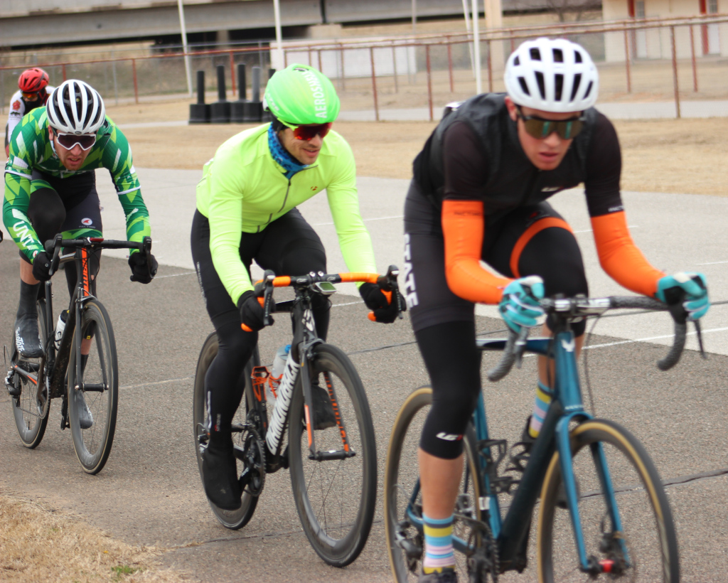 Zach+Gregg+%28center%29%2C+exercise+physiology+graduate+considers+next+move+while+riding+within+chasing+group.+Photo+by+Sharome+Burton.+March+10.