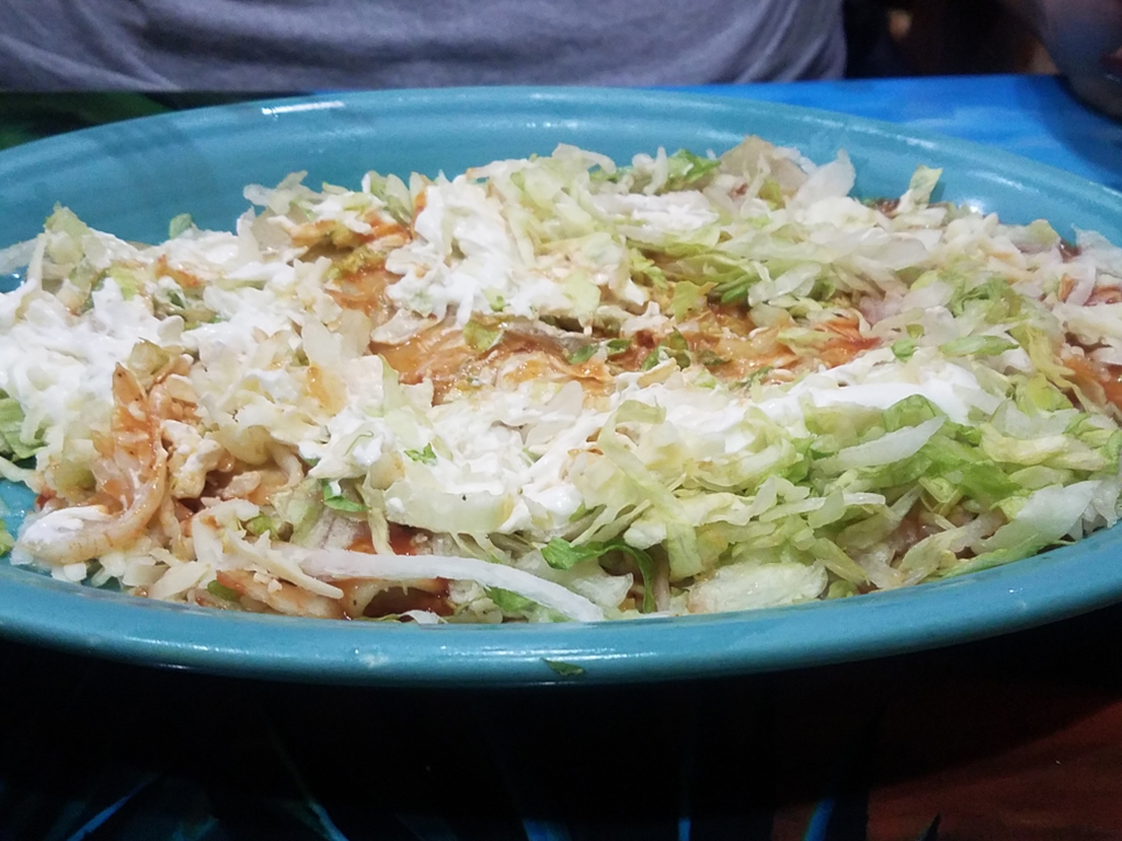 Enchilada supremas with red sauce, cheese, sour cream and lettuce from El Tapatio March 4. Photo by Jair Ellis