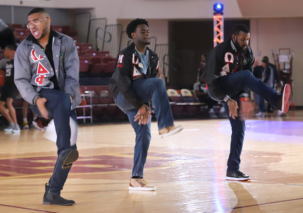 Omega Delta Phi members show off their step routine at Mustang Madness, Oct 25. Photo by Bridget Reilly