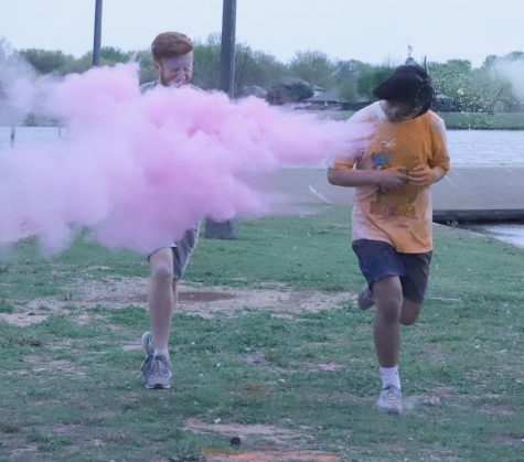General business freshman Austin Strode and general business freshman Erick Lopez run through the dry paint at the 5Kolor run at Sikes Lake for Wichita Falls Faith Mission. April 2. Photo by Bridget Reilly