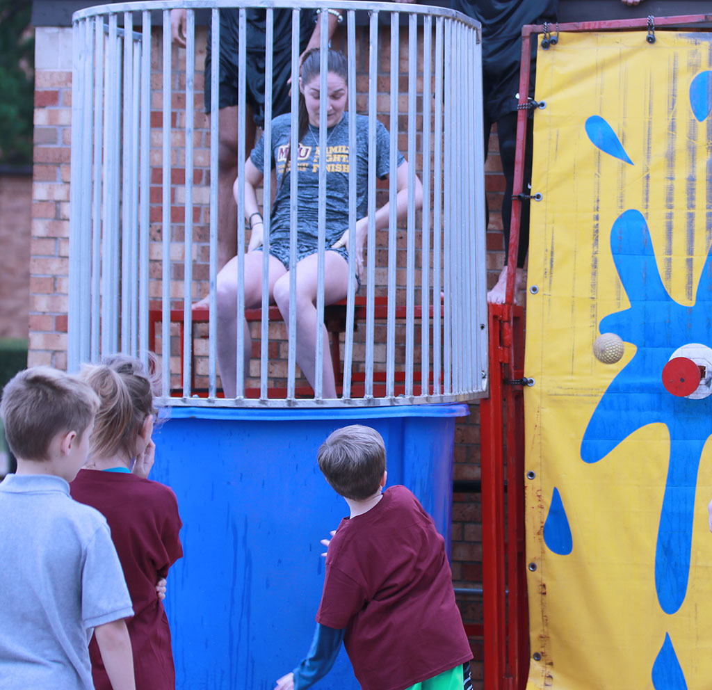 Nursing senior Kylee Gorney gets dunked by a participant at the SAAC Field Day. April 16. Photo by Brianne Fournier