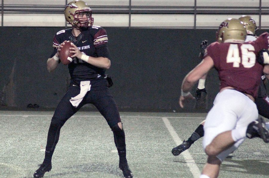 Business finance sophomore and quarterback Zach Purcell scans the field of play in the Maroon v. Gold game. April 12. Photo by Taylor Anderson