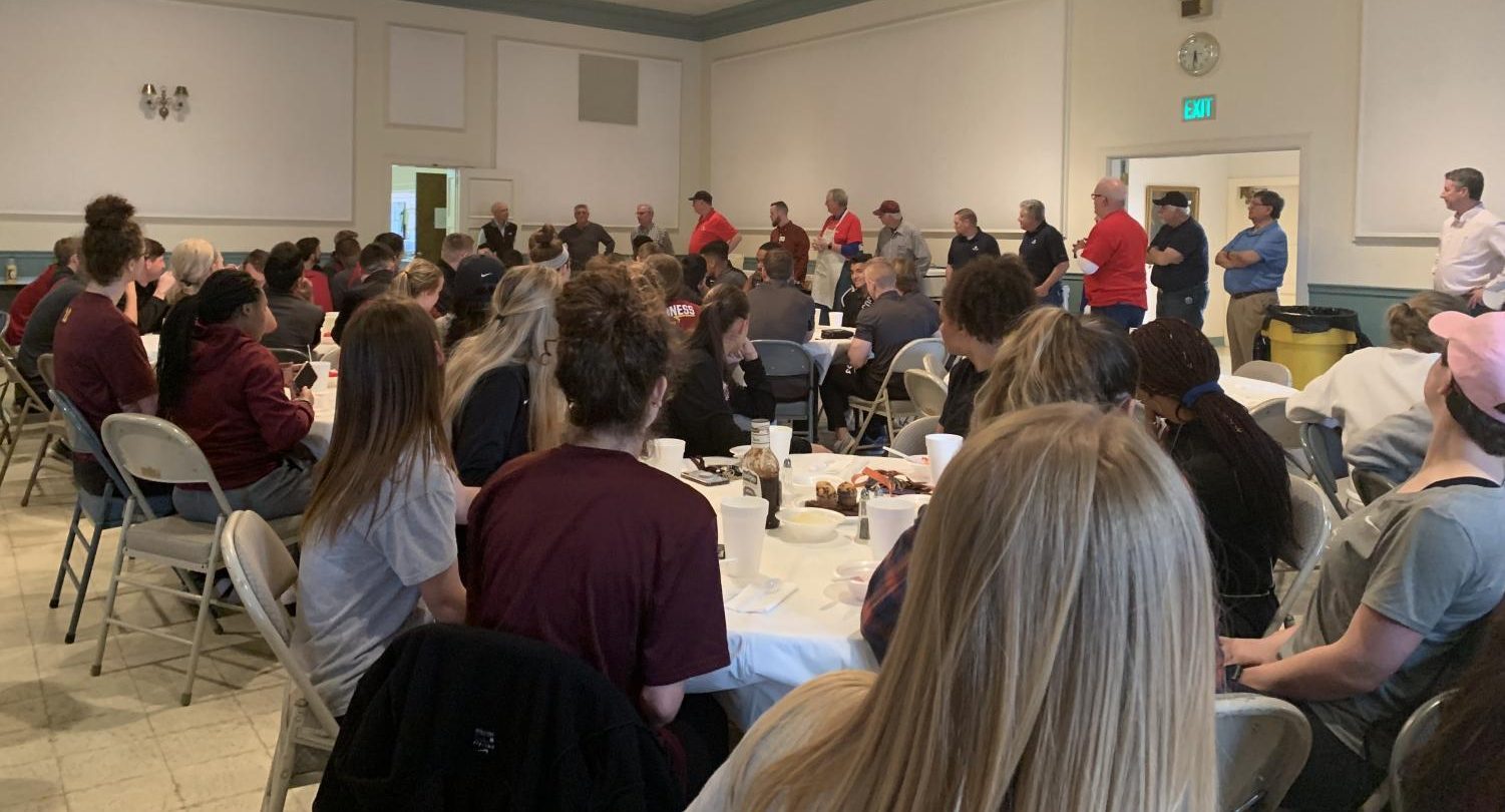 Student-athletes gather at First Christian Church for Mustangs Meal on April 3.