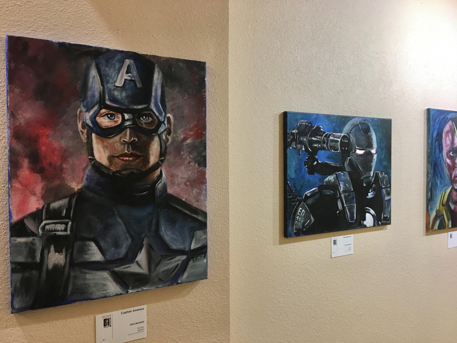 Chris Mayfield's paintings of Captain America, War Machine, and Vision are on display at The Kemp. Photo by Peyton Alonzo