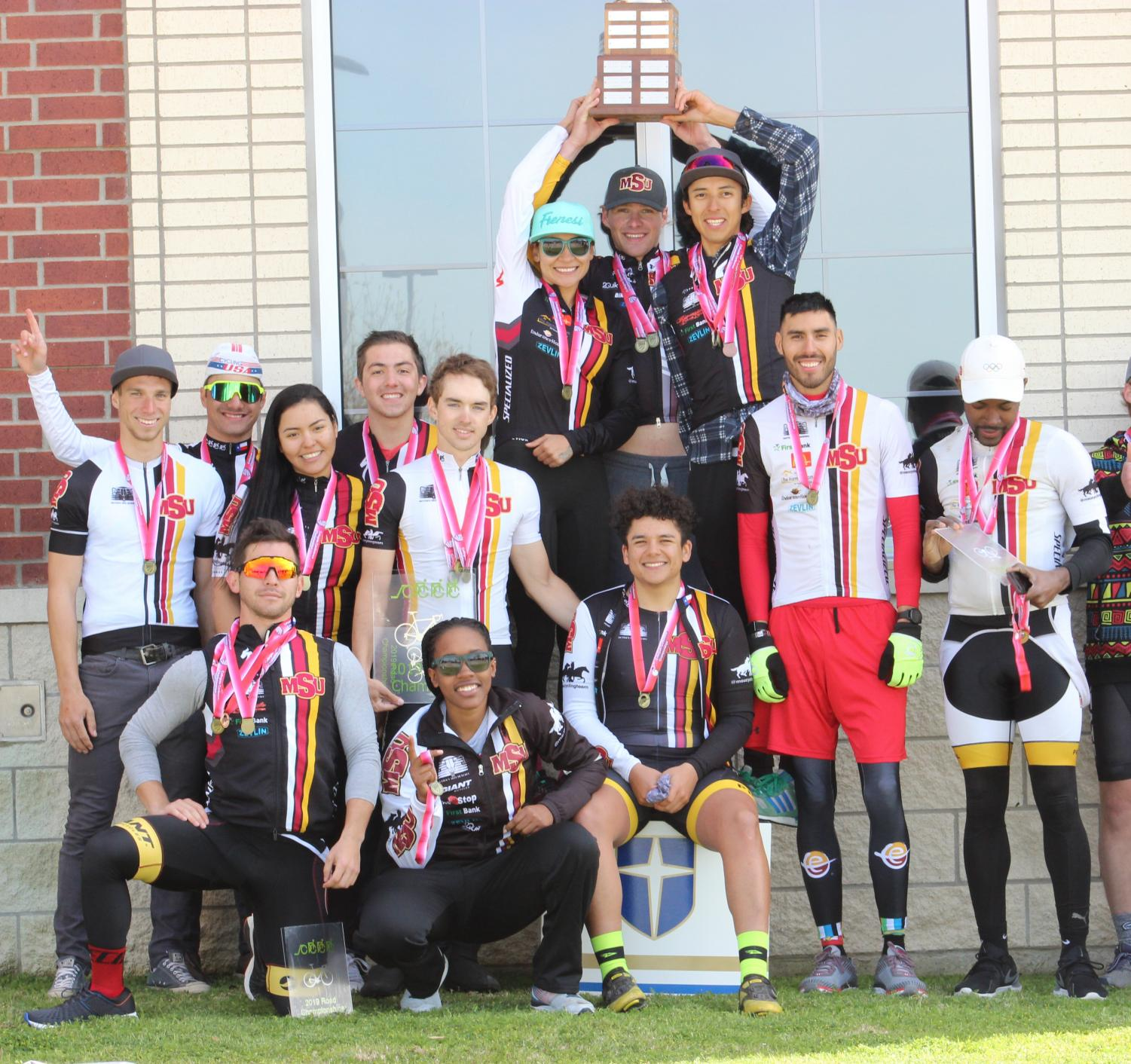 Cycling team celebrates 13th consecutive title at South Central Collegiate Cycling Championships. Photo by Charlie Zamastil. March 31.