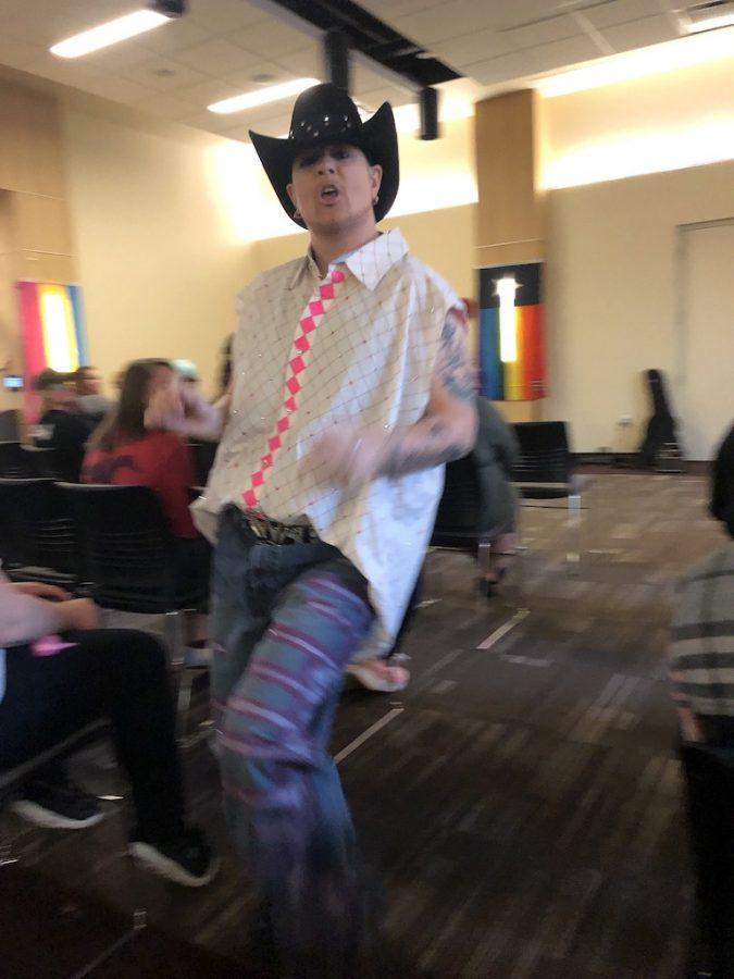 Romeo Casanova, dances in aisle as part of drag performance.