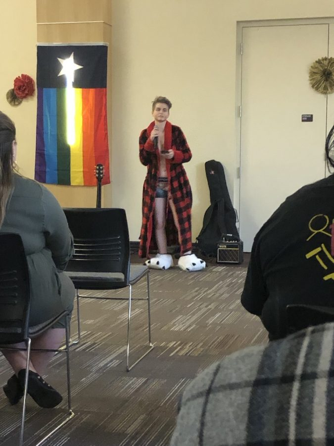 Drag king in robe and bunny slippers