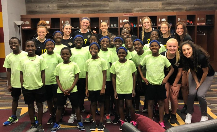 Women's soccer team gather for picture with Daraja Children's Choir from Uganda before an afternoon of soccer. Photo credits: Chelsea Knaack