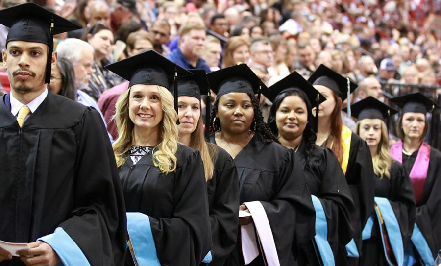 Seniors wait to cross the stage to become graduates at the graduation ceremony at Kay Yeager Coliseum on May 11.