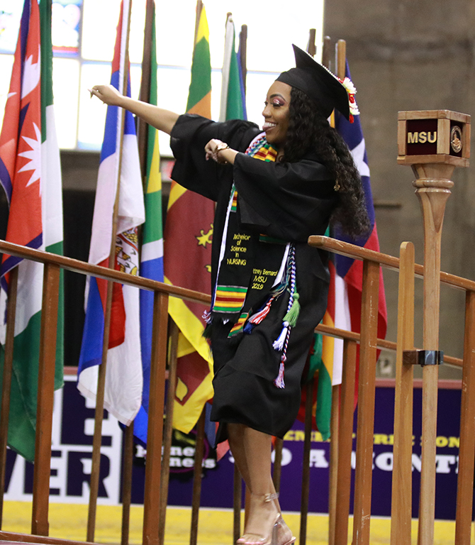 Nursing graduate Brittney Bernard dances across the stage as she goes to accept her degree at the graduation ceremony at Kay Yeager Coliseum on May 11.