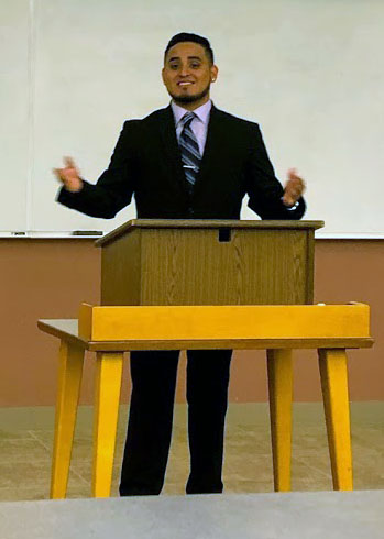 Issac Nunez, marketing junior,  presents his final exam to his Foundations of Business class April 25.