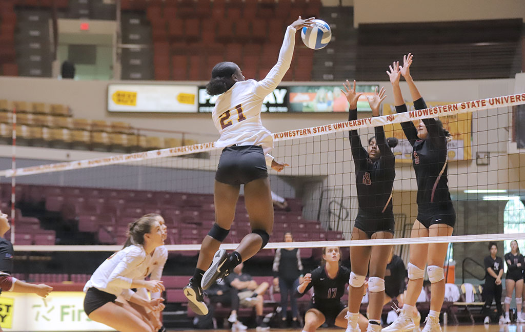 Mechanical engineering junior and right side Raven Presley leaps into the air for a huge spike, scoring against Southern Nazarene University. Oct 8. Photo by Bridget Reilly