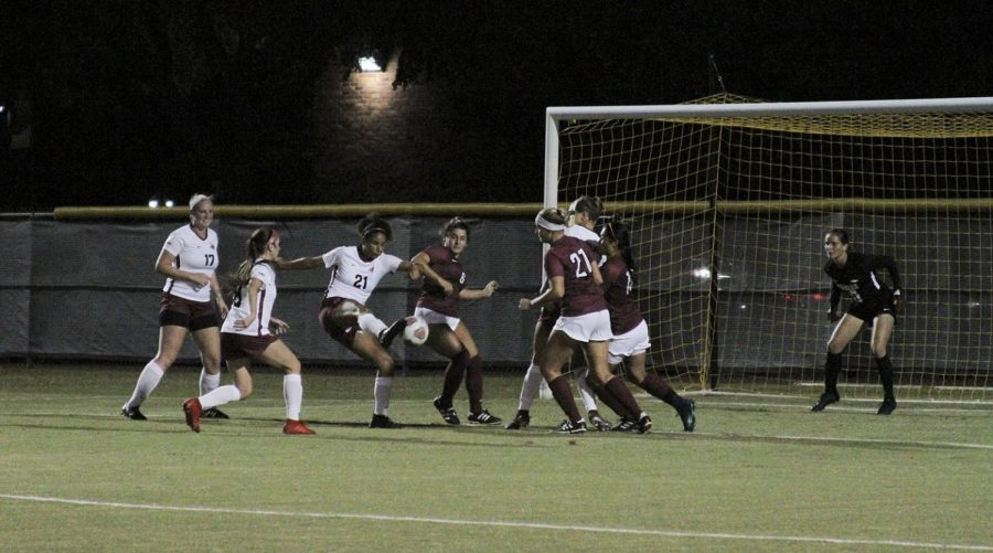 Kinesiology+senior+and+defender+Imani+Morlock+makes+a+shot+for+the+goal.+Oct+17.+Photo+by+Colin+Stevenson.