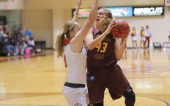 Women's basketball earns first win