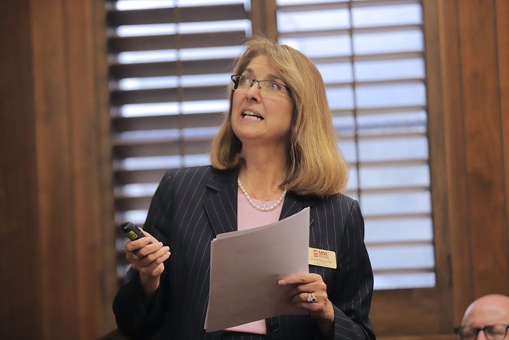 Vice President of Administration and Finance Beth Reissenweber delivers preliminary informatiion regarding the FY 2019 end-of-year report at the Board of Regents meeting. Nov. 7. Photo by Bridget Reilly