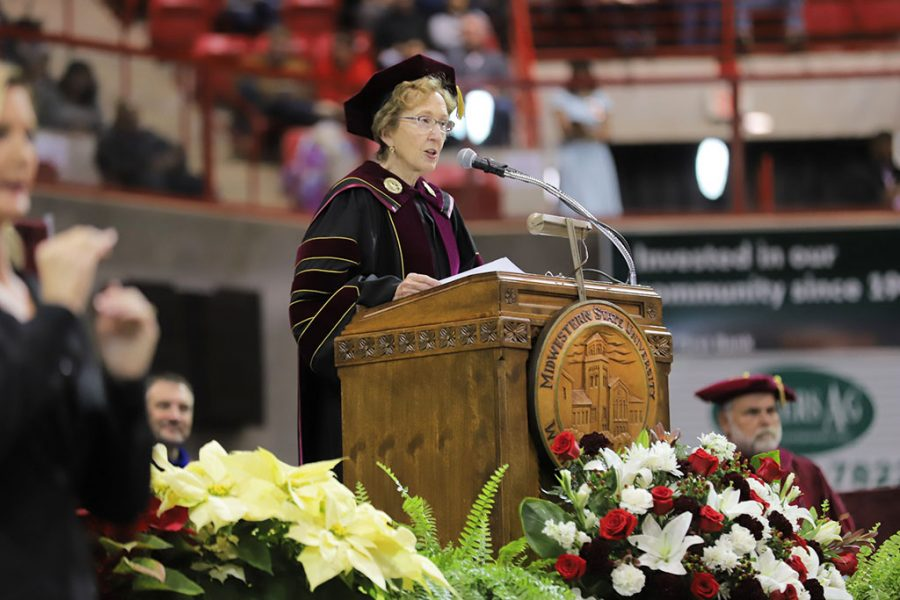 President+Suzanne+Shipley+introduces+the+commencement+speaker+at+graduation+2019.+Dec+14.+Photo+by+Cole+Sheriff.
