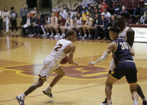 Trae Jones dribbles the ball past an opponent