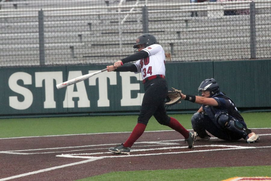 Sophomore Bailey Wamsley swings and hits a fast ball.