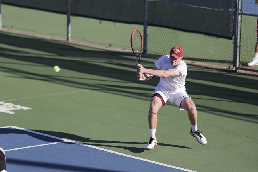 Mechanical engineering sophomore Ben Westwick returns the volley