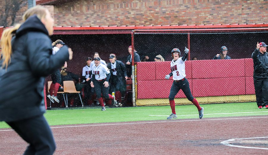 Business sophomore and inside fielder Brook Taylor points to special education senior and outside fielder Lauren Lindgren after she hits a home run, allowing Taylor to get a run on the board against UT Tyler. March 8.