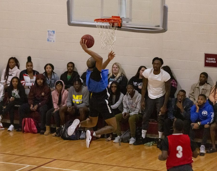 A member of team 'The Royal Family' dunks the ball while the crowd watches. March 5. Photo by Colin Stevenson.