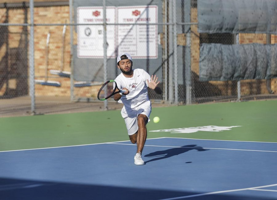 Business management senior Angel Palacios lunges for the ball
