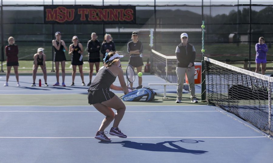 Marketing+senior+Ashley+Ramirez+returns+at+the+net+in+her+doubles+match.+March+7.