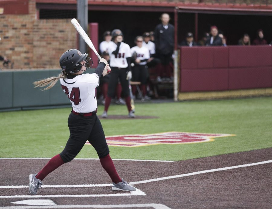 Bailey Wamsley watches the ball fly after her swing